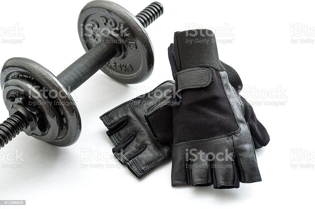 Gym and workout concept with exercising gloves and a dumbbell – Foto