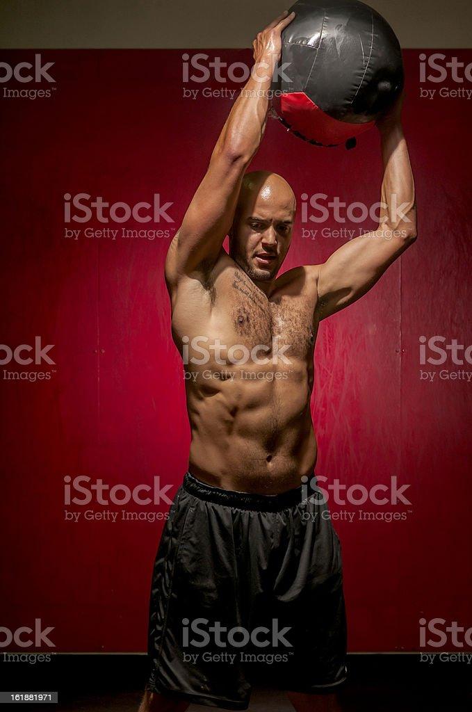 gym athlete medicine ball chops stock photo