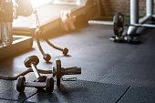 istock Gym background Fitness weight equipment on empty dark floor 1213615970