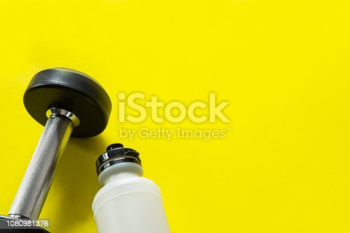 istock Gym background with dumbbell and sport bottle 1080981376