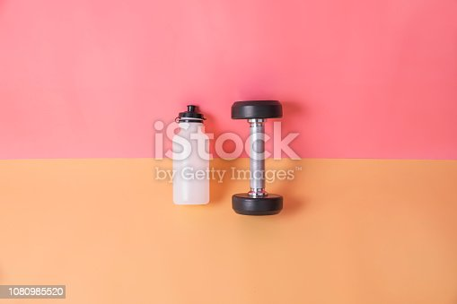 istock Gym background with sport fitness equipment minimal pastel 1080985520