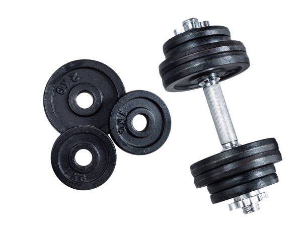 gym dumbbells on white background. photograph taken from above - тренажер стоковые фото и изображения