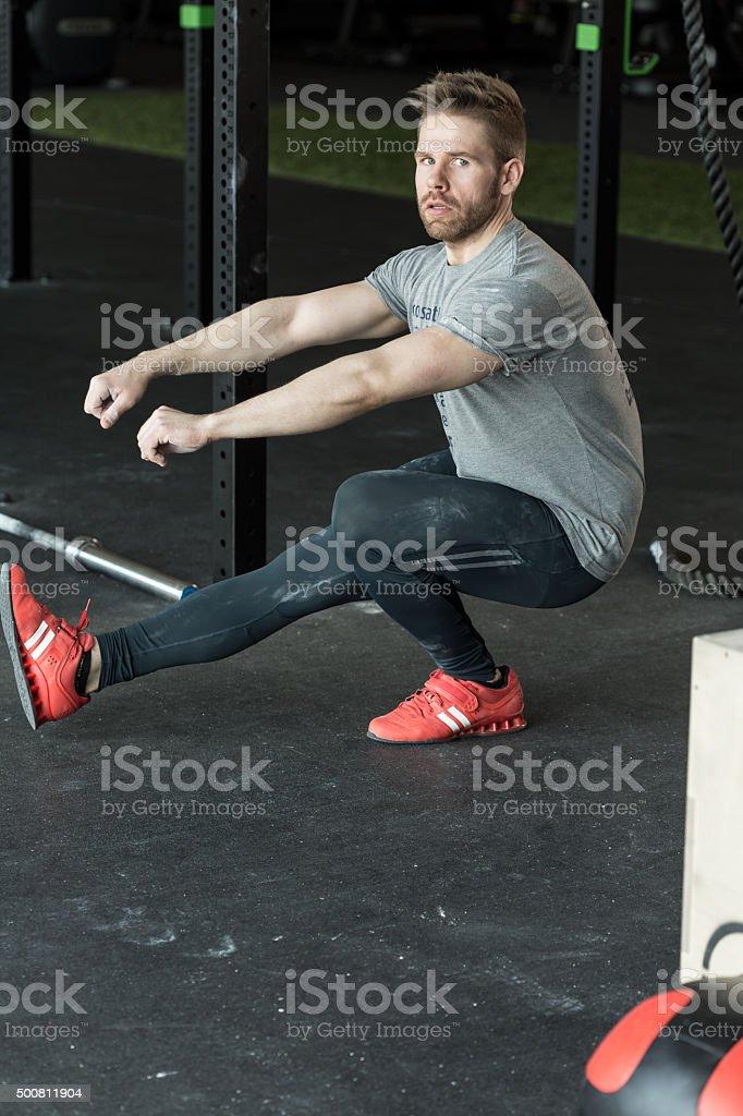 gym exercise - pistol squats stock photo