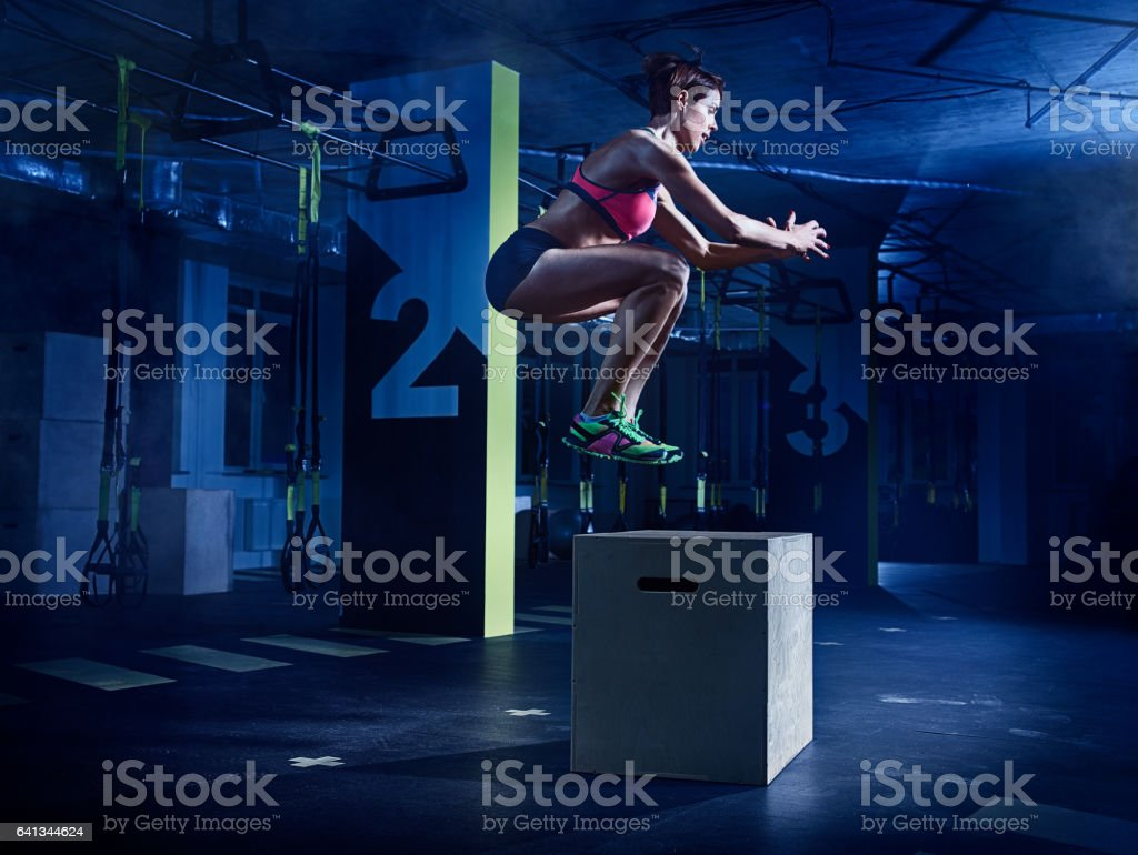 gym: Female athlete in action stock photo