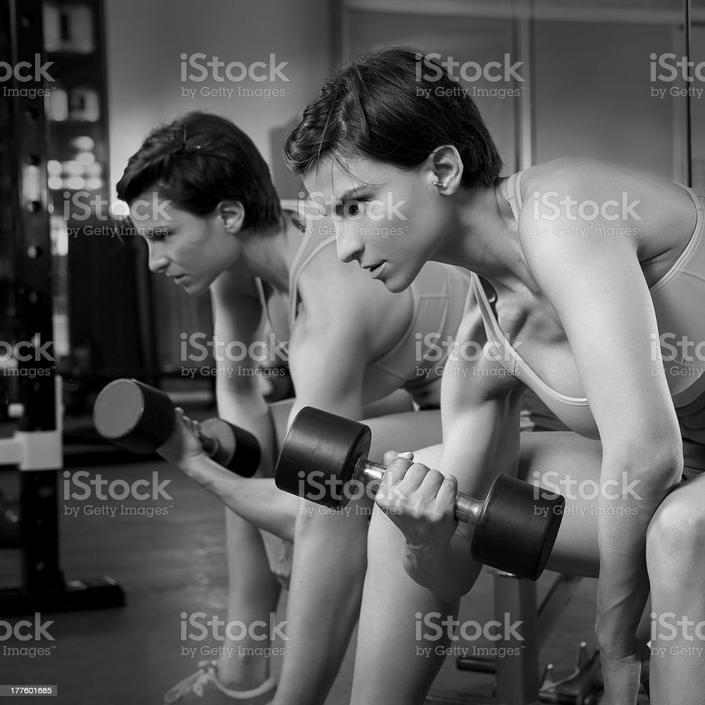 gym fitness weight lifting Dumbbell woman at mirror royalty-free stock photo