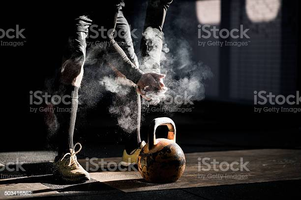 Gym fitness workout: Man ready to exercise with kettle bell Gym fitness workout: Man ready to exercise with kettle bell 20-24 Years Stock Photo