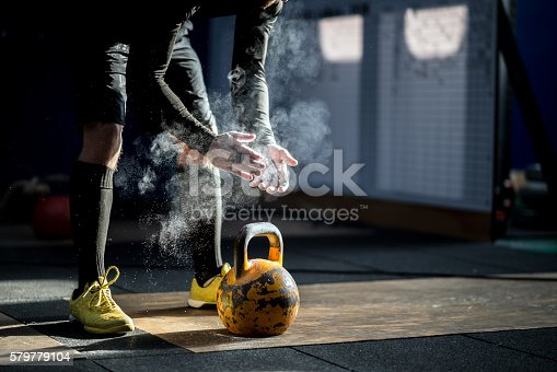 istock Gym fitness workout: Man ready to exercise with kettle bell 579779104