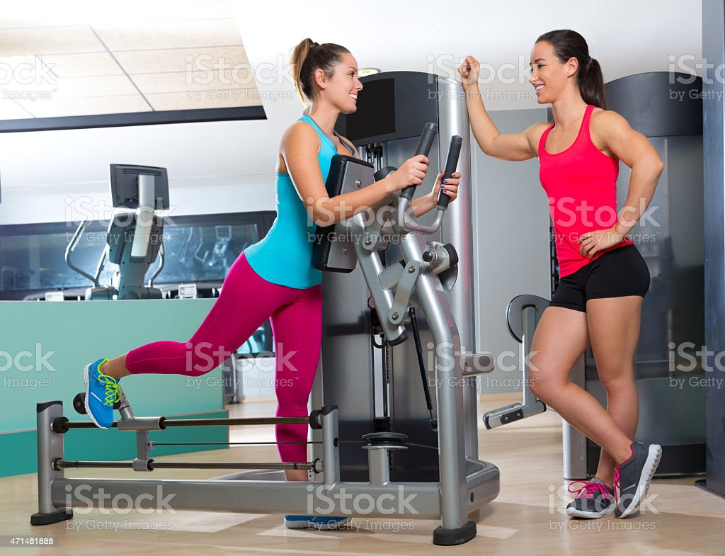 Gym glute exercise machine woman workout stock photo