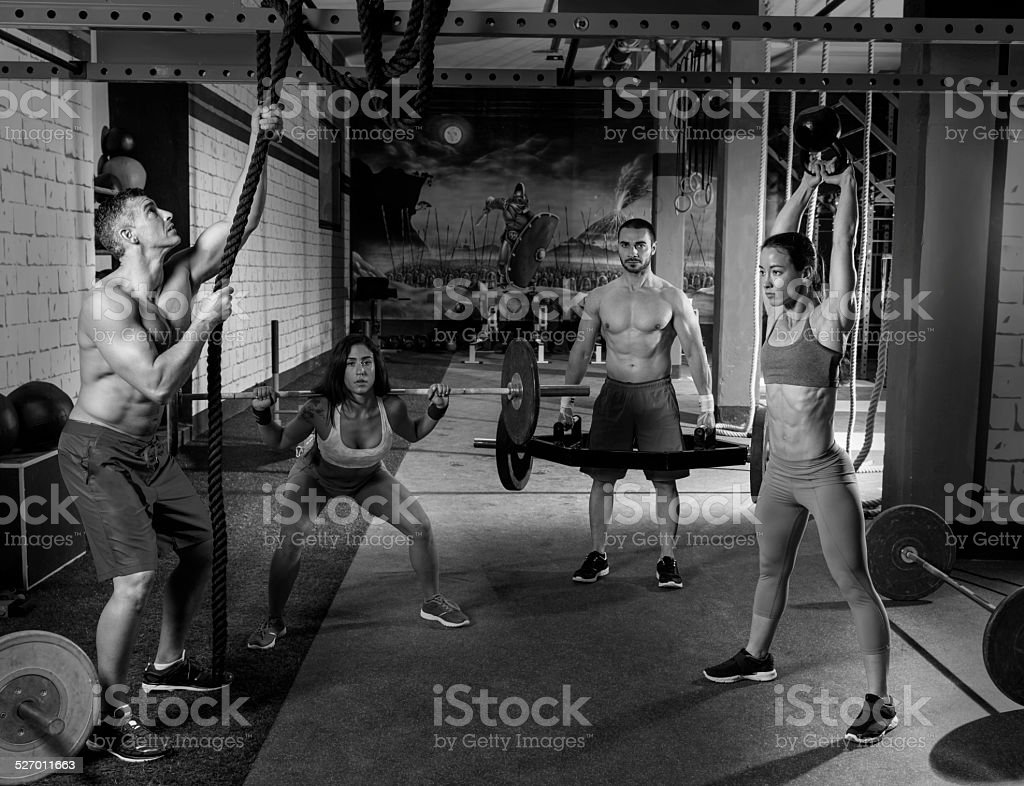 gym group weightlifting workout men and girls stock photo