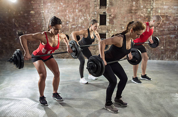gym group with weight lifting workout stock photo