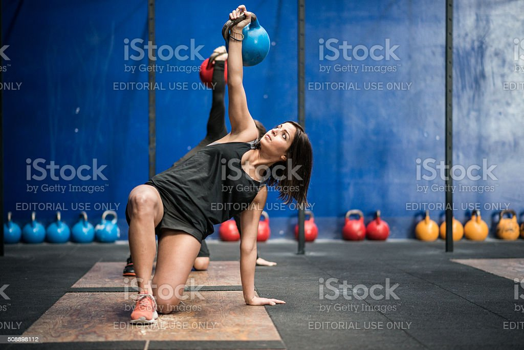 gym gym workout: Kettle bell class stock photo
