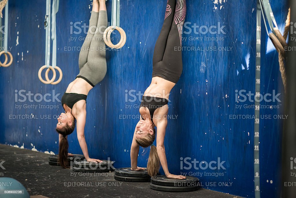 gym gym workout: Wall handstand stock photo