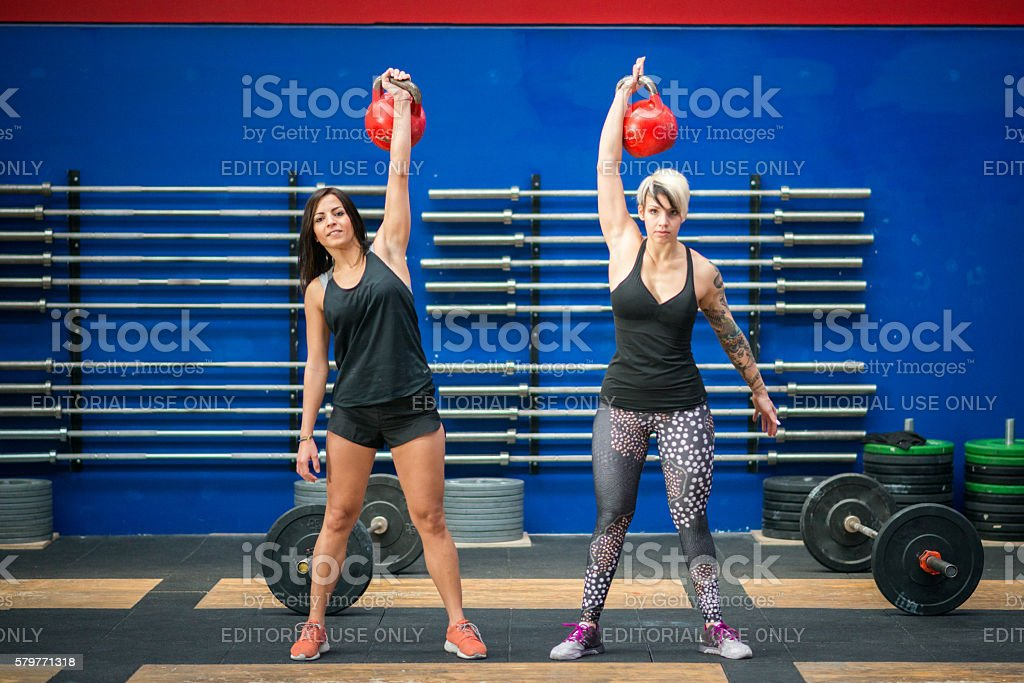 gym gym workout: Women with kettle bells stock photo