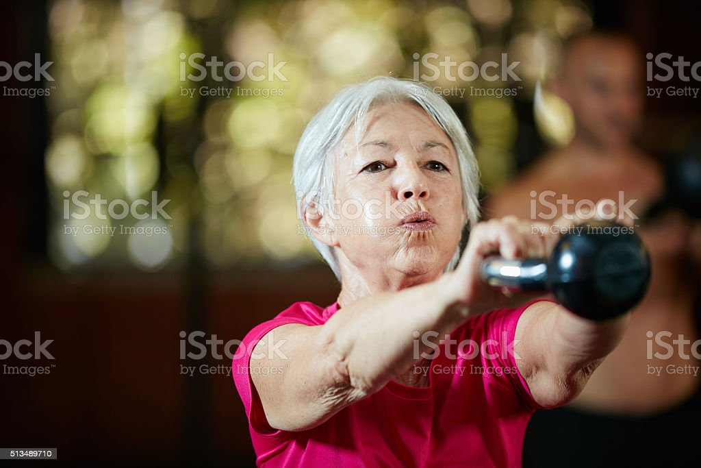 Gym is her power hour Shot of a senior woman working out with a kettle bell at the gymhttp://195.154.178.81/DATA/i_collage/pu/shoots/806424.jpg Active Lifestyle Stock Photo