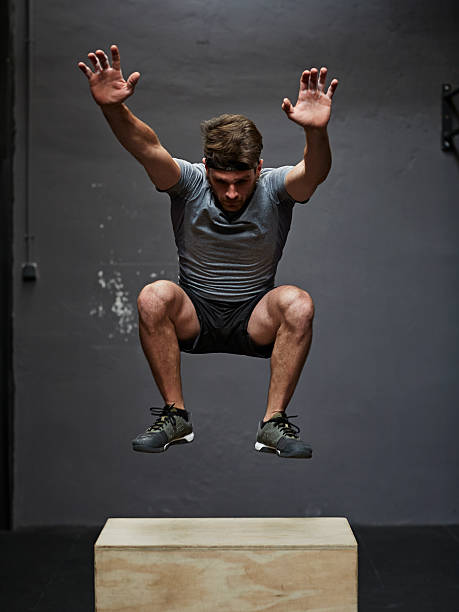 gym jumping on box stock photo