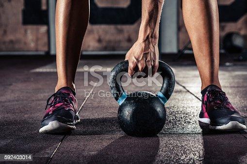 istock gym kettlebell training in gym 592403014