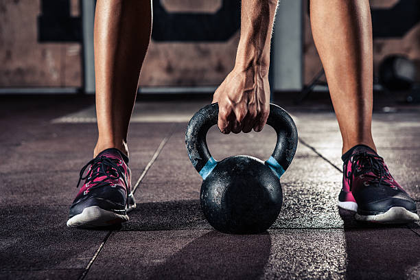 gym kettlebell training in gym stock photo