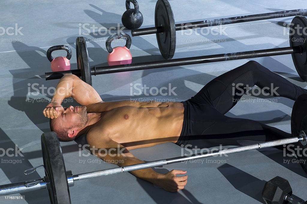 gym man exhausted after intense workout royalty-free stock photo