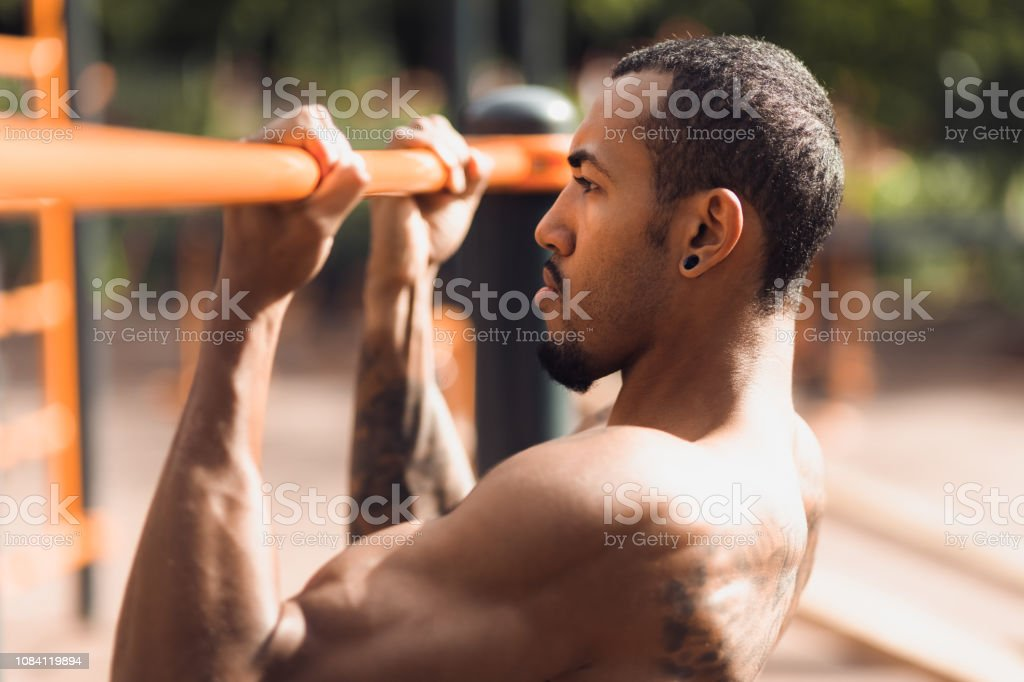 Gym Man Working Out Pullups On Chinup Bar Stock Photo