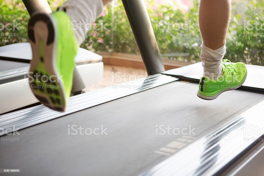 Gym Male running on treadmill, selective focus Activity Stock Photo