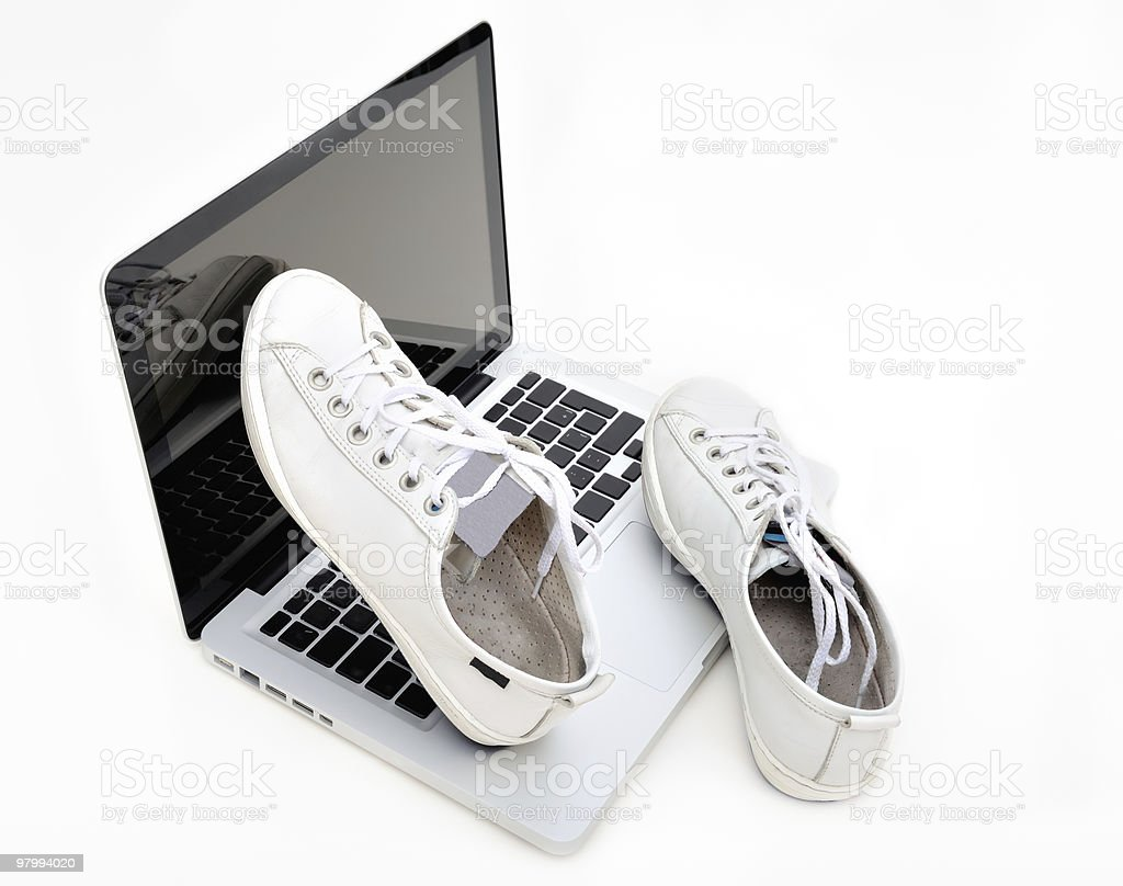 Gym shoes on notebook royalty-free stock photo