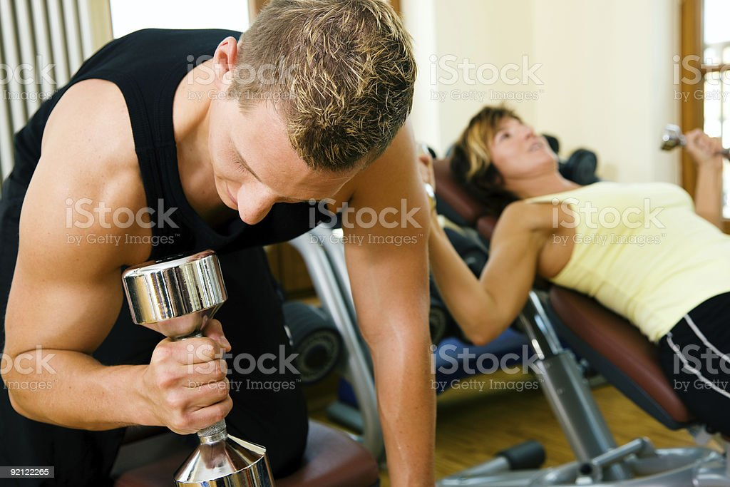Gym training with dumbbells royalty-free stock photo