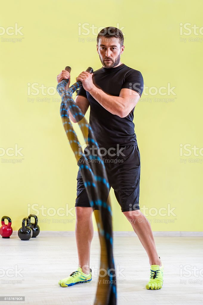 Gym training with ropes stock photo