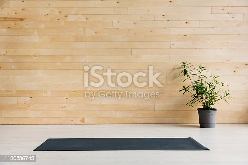 istock Gym with yoga mat interior 1130536743