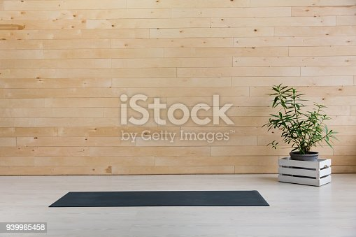 istock Gym with yoga mat interior 939965458