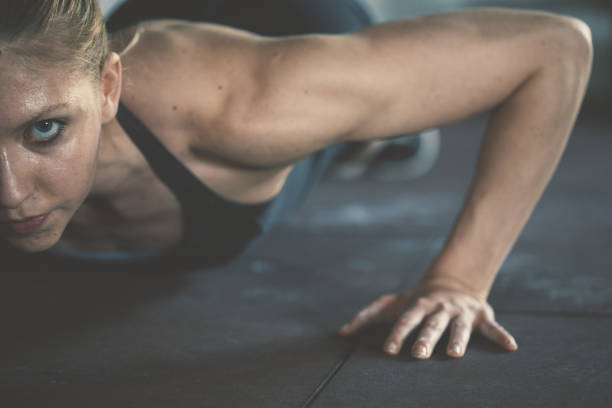 gym woman exercising in gym stock photo