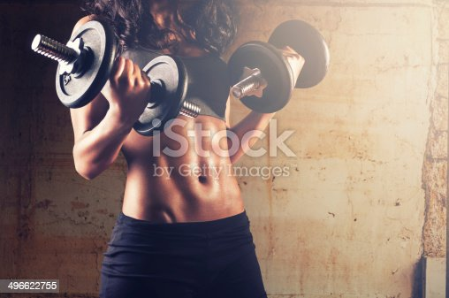istock gym woman with dumbbells 496622755