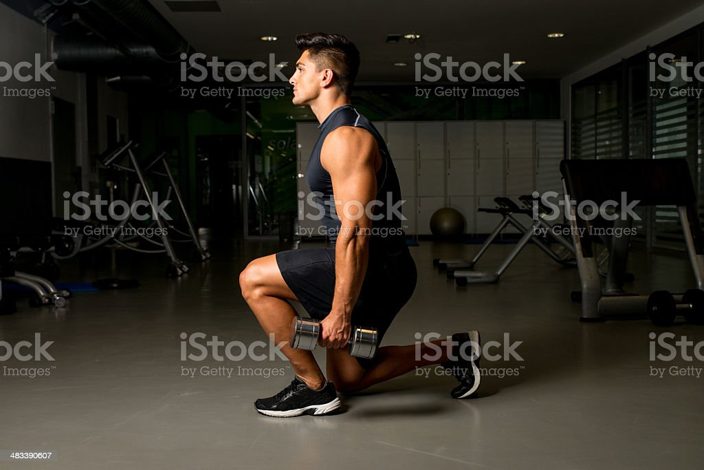 Gym Workout with Dumbbell Lunge stock photo