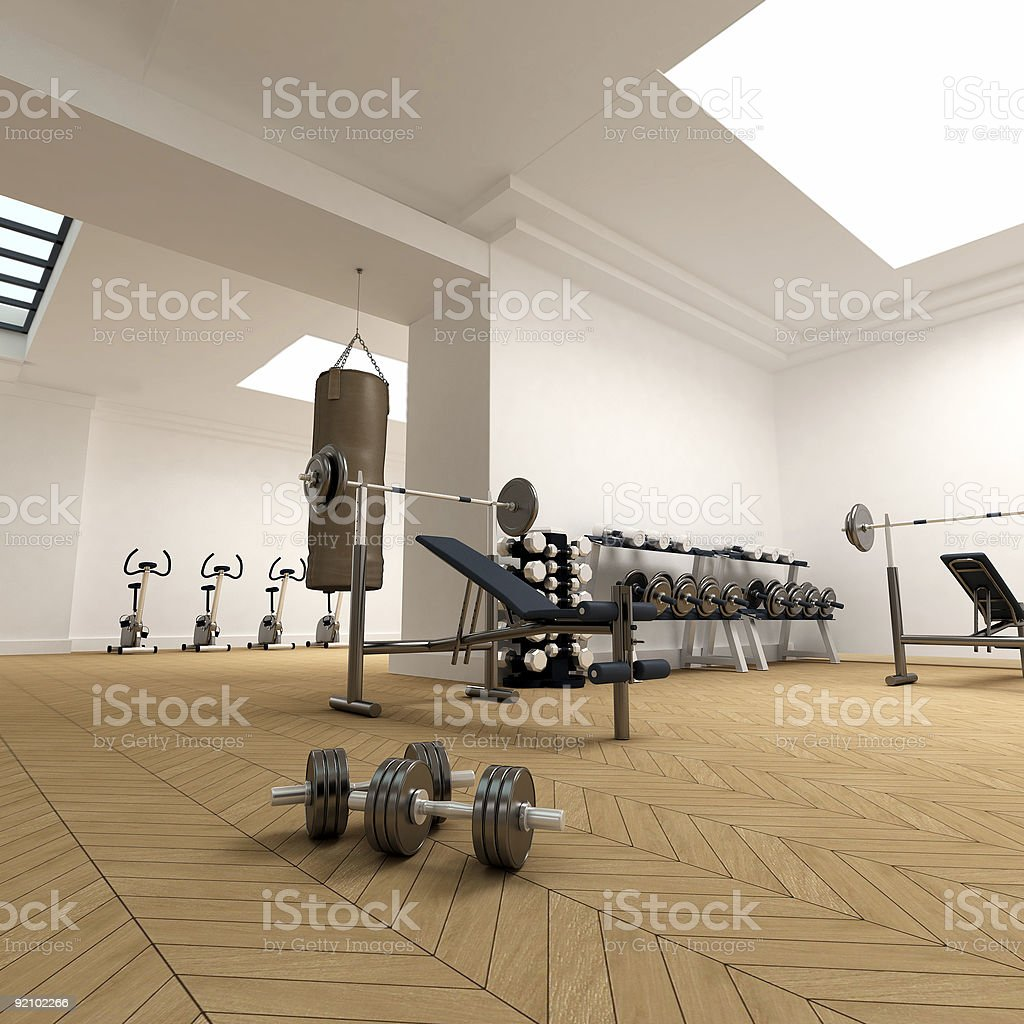 Gymnasium filled with weights and fitness equipment royalty-free stock photo