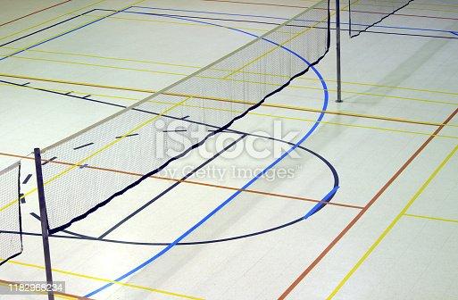 518943593istockphoto gymnasium indoor sports badminton net white floor lines playground 1182968234