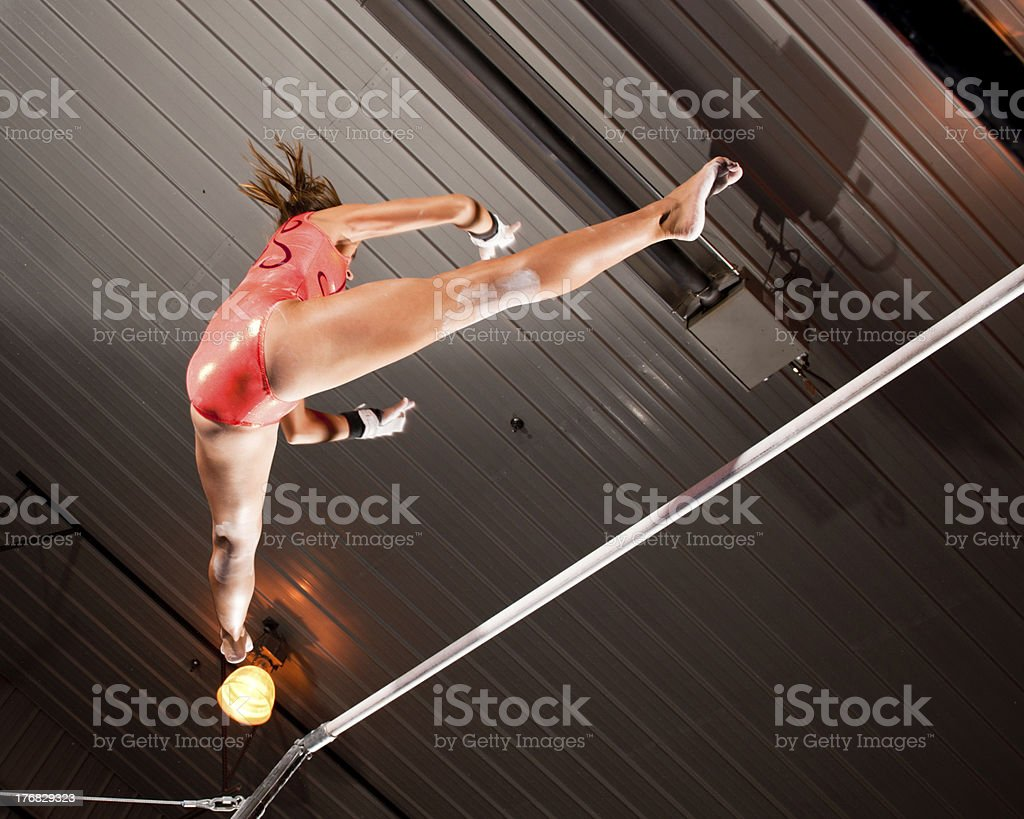 Gymnast About to Catch The Bar (Low Angle View) stock photo