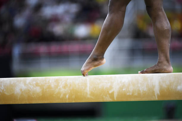gymnast feet - balance beam stock photos and pictures