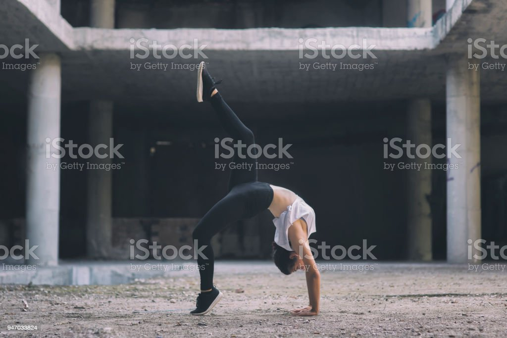 Gymnast girl acting on the street royalty-free stock photo