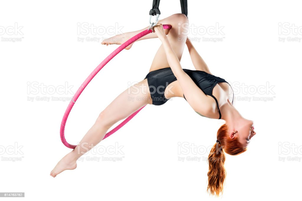 Gymnast in an airy ring trains on a white background stock photo