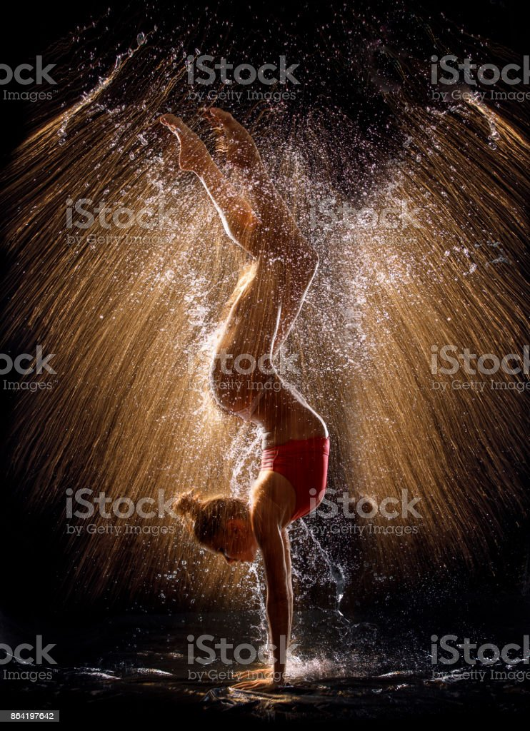 Gymnast in the spray of water royalty-free stock photo