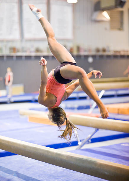 Gymnast Mid-Flip on Balance Beam stock photo