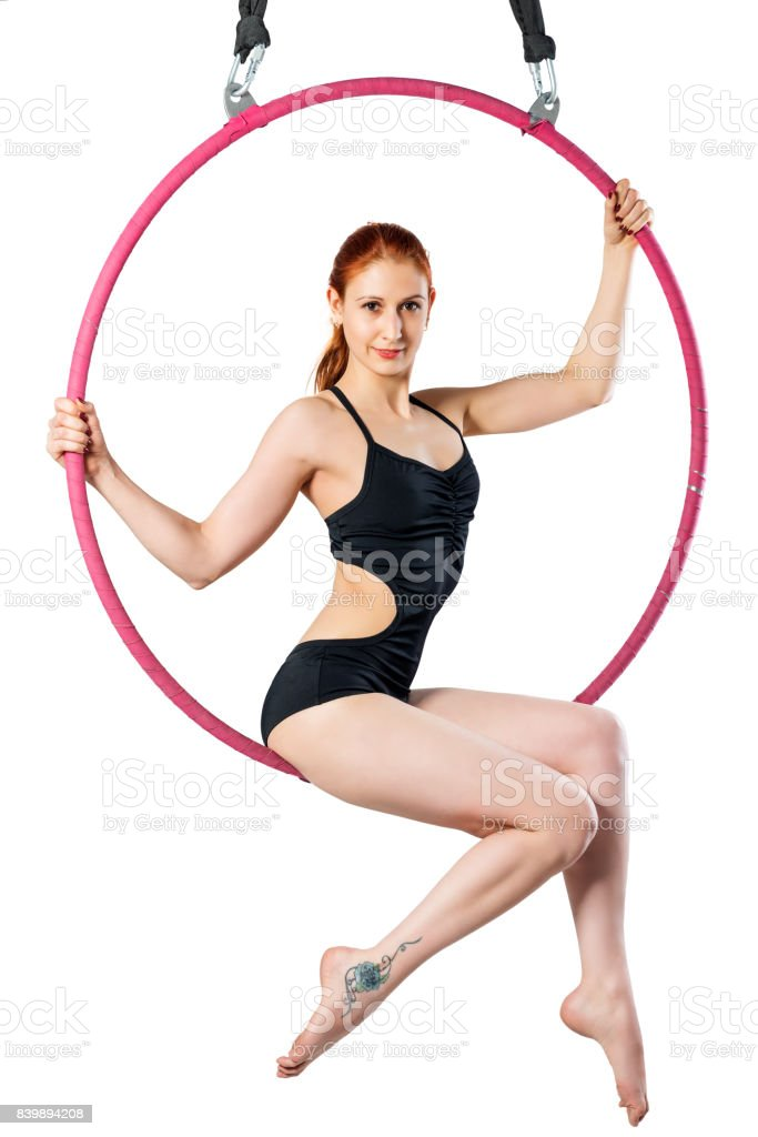 Gymnast on an air ring on a white background in a black swimsuit poses stock photo