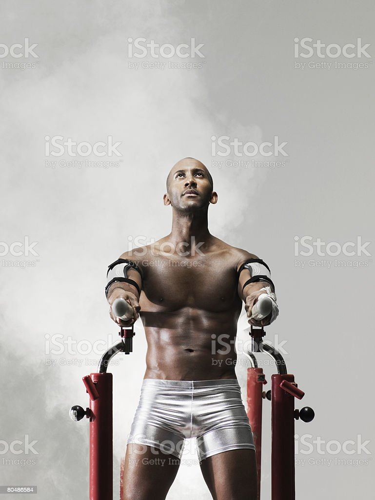 A gymnast on parallel bars royalty-free stock photo