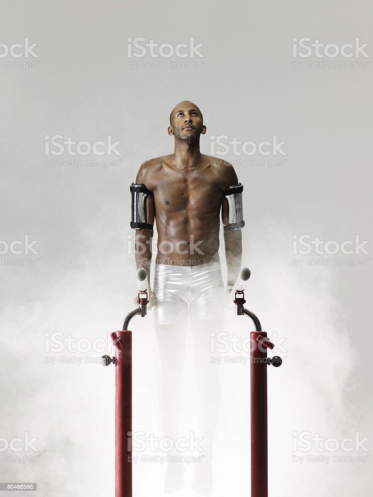 A gymnast on parallel bars 免版稅 stock photo