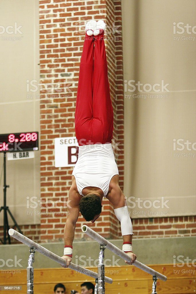Gymnast on parallel bars - Royalty-free Adult Stock Photo