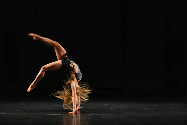 gymnast performing handspring stock photo