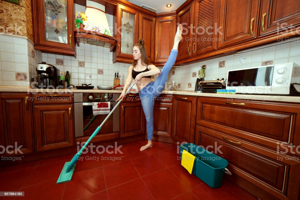 Gymnast washes the floors. stock photo