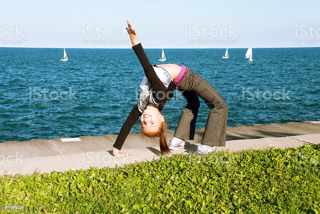 Gymnastic exercises on the lake shore stock photo