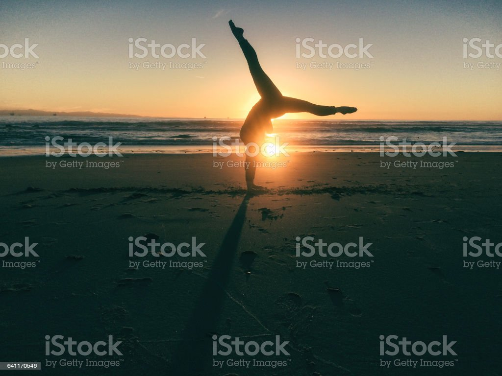 Gymnastic strength at sunset stock photo
