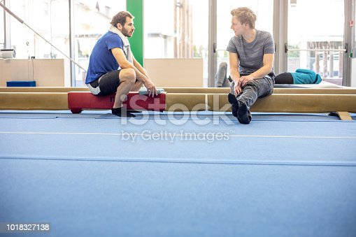 Gymnastics Athlete Having a Discussion with Young Man.