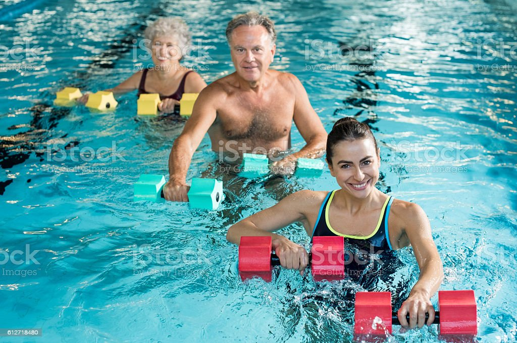 Gymnastics physiotherapy with dumbbells - foto de stock